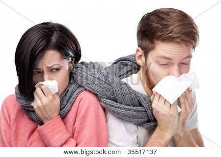 Colds man and woman, wrapped in a scarf
