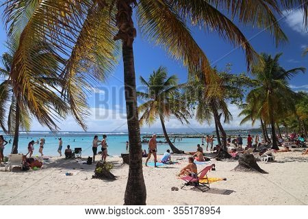 Guadeloupe, France - December 8, 2019: People Spend Beach Vacation In Sainte Anne On Guadeloupe Isla