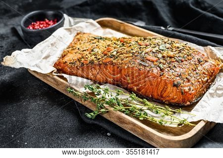 Hot Smoked Salmon Fillet On A Cutting Board. Trout. Black Background, Top View.
