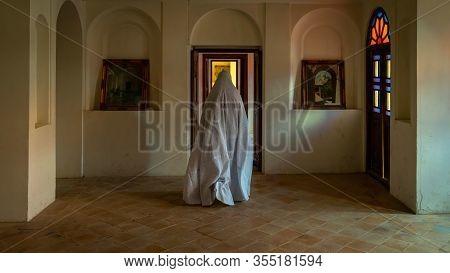 Kashan, Iran - May 2019: Unidentified Iranian Woman In Chador Hijab Walking Inside Of Tabatabaei Nat