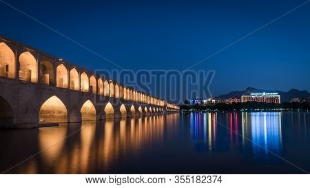 Isfahan, Iran - May 2019: Siosepol Bridge Or Bridge Of 33 Arches During Blue Hour, One Of The Oldest
