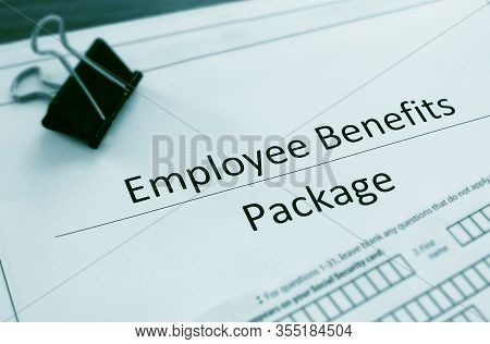 Employee Benefits Package And Employment Forms Close Up