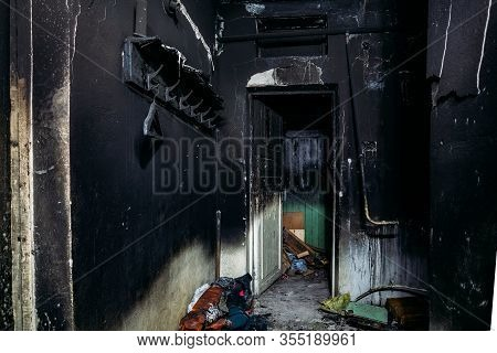 Consequences Of Fire. Burnt House Interior. Charred Walls And Ceiling In Black Soot