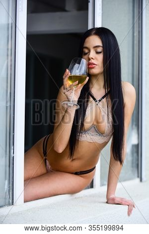 Perfect Body In Sexy Lingerie. Sexy Lace Lingerie. Woman Seductive Model Enjoy Wine. Girl With Alcoh
