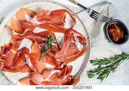 Prosciutto Crudo, Italian Salami, Parma Ham. Antipasto Plate. Gray Background, Top View.