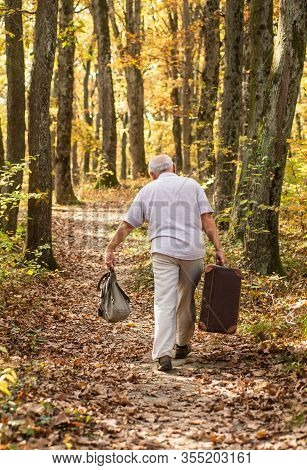 Always Have Bag Ready To Go. Elderly Person Carry Travel Bag. Old Man Travel With Retro Bag. Living