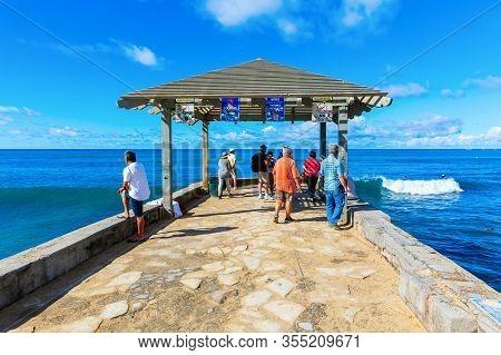 Pier At Kuhio Beach Park In Honolulu, Hawaii