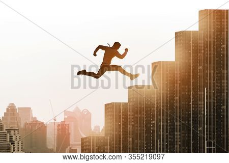 Young Businessman Jumping High On Staircase, Celebrate Success Winning Pose On Building Rooftop. Wor