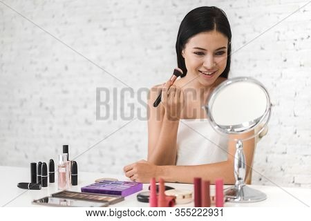 Smiling Of Young Beautiful Pretty Woman Clean Fresh Healthy White Skin Looking At Mirror.girl Holdin