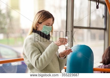 A Blonde Young Woman, Girl Wearing Surgery Medical Mask Protecting By The Coronavirus, Covid2019 Usi