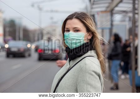 Cheerful Woman Wearing A Sterile Protective Medical Mask Against Coronavirus, Covid-2019 Asian Pande