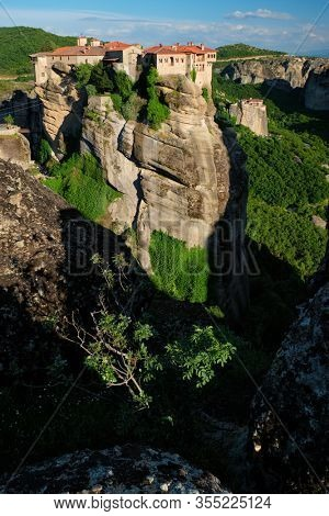 Monastery of Varlaam and Monastery of Rousanou in famous greek tourist destination Meteora in Greece on sunset with scenic scenery landscape