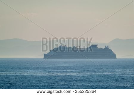 Cruise liner ship silhouette in Mediterranea sea. Aegean sea, Greece