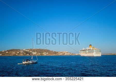 Boat yacht and cruise liner is Aegean sea on beautiful summer day. Chora, Mykonos island, Greece