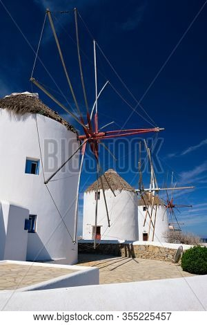 Scenic view of famous Mykonos town windmills. Traditional greek windmills on Mykonos island, Cyclades, Greece
