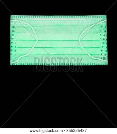 Closeup Of Surgical Medical Particulate Protective Green Mask On Isolated Background. Using For Heat