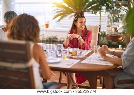 Young beautiful girl smiling happy and confident sitting dinking cup of coffee at terrace