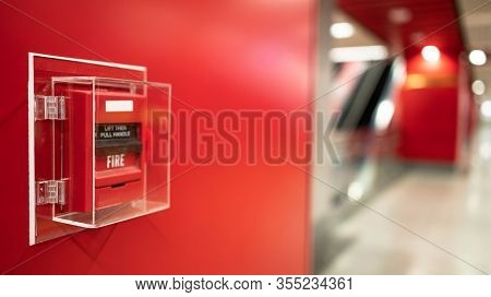 The Red Fire Alarm Switch On The Wall At The Bangkok Subway.