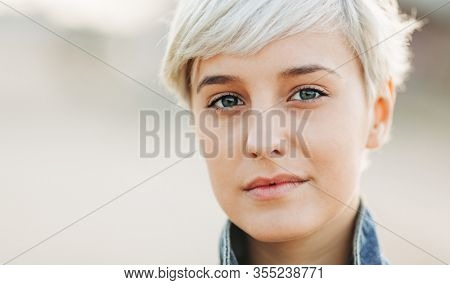 casual portrait of beautifu blond young woman outdoors