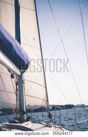 White Cloth Fabric, Masts And Ropes Close-up On Sail Of Tri-yacht Or Yacht Sailing Boat