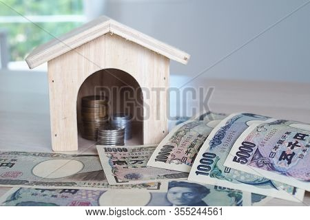 Japanese Yen Notes And Japanese Yen Coins For Home And Money Concept Background