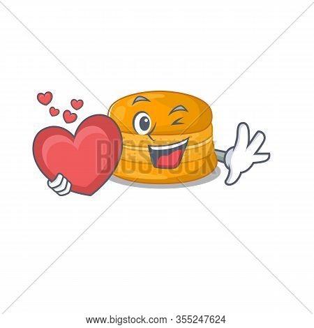A Romantic Cartoon Design Of Orange Macaron Holding Heart