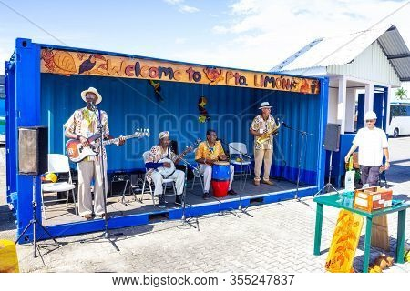 Puerto Limon, Costa Rica - December 8, 2019: View Of Local Men Welcoming Tourists At Port At Puerto