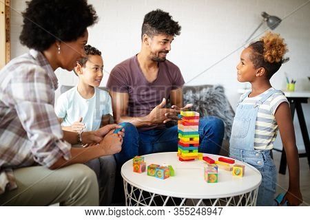 Happy Black Family Playing Game Together At Home