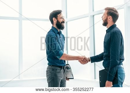 Business People Shaking Hands Before Starting A Business Meeting