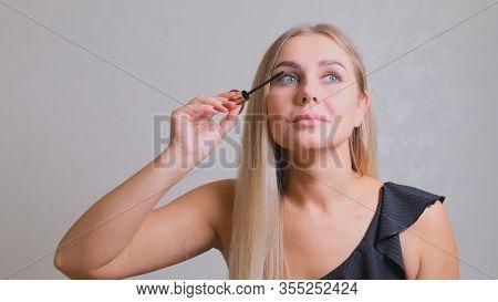 Makeup. Make-up. Applying Mascara. Long Eyelashes. Woman Applying Eye Mascara To Her Eyelashes