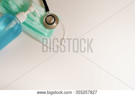 Closeup Blue Bottle Of Alcohal, Surgical Medical Particulate Protective Green Mask And Stethoscope F