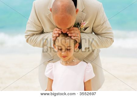 Father Giving A Kiss On The Head Of His Daughter, The Flower Girl ( Wedding Day )