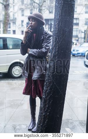 London, Uk- Febryary 15 2020: Fashionable People On The Street . Street Style. Girl In A Brown Leath