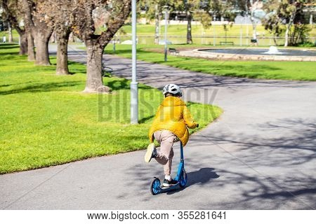 Young Boy Riding His Scooter In Adelaide City On A Day