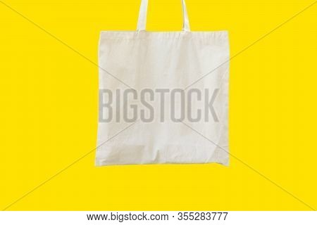 Blank Cotton Shite Shopper Tote Bag On Yellow Background. Mock Up Template For Product Branding Plas