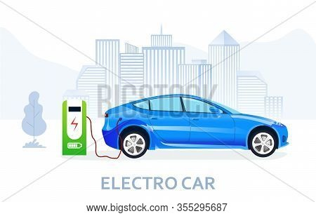 Blue Electric Car Being Charged On Power Supercharger Station, Viewed From The Side. Eco Friendly Te