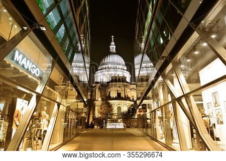 LONDON, UK - SEP 27: St Pauls Cathedral at night with glass reflections on September 27, 2013 in London, UK. London is the world's most visited city and the capital of UK.
