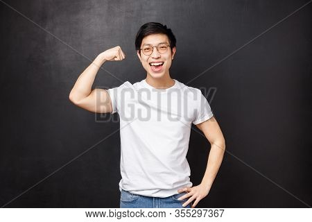 Proud And Boastful Handsome Asian Guy Workout At Gym, Glex Biceps To Show Girlfriend How Strong He I