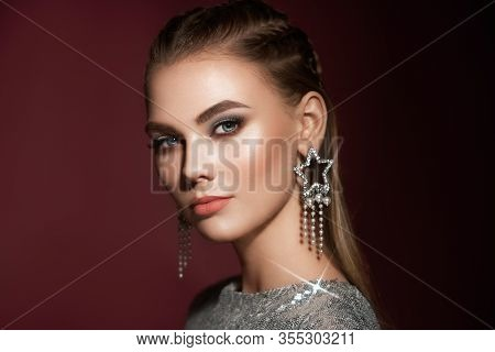 Portrait Beautiful Woman With Jewelry. Brunette Girl With Long Smooth Hair. Beauty Fashion. Eyelashe