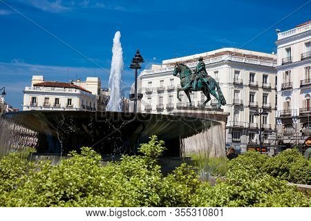 Madrid, Spain - May, 2018: Fountain And The Equestrian Statue Of Carlos Iii Located At Puerta Del So
