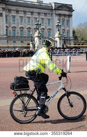 London, United Kingdom, March 8th 2020:- A Police Officer On A Bike Outside Buckingham Palace