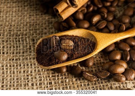 Coffee On Wooden Spoon On A Burlap Textured Background