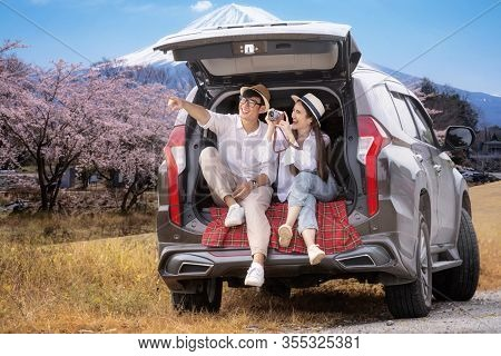 Asian Couple Travel Fuji Mountain By Suv Car, This Image Can Use For Car Rental, Travel, Japan, Outd
