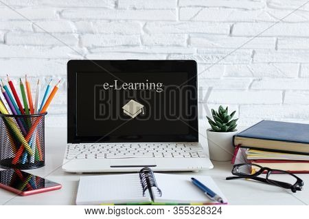 Workplace With Laptop And Books. E-learning, Online Education Concept.