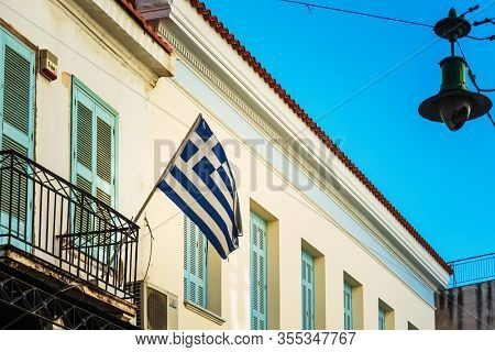 ATHENS, GREECE - February 29, 2022: Greek flag in Athens, Greece