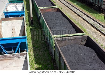 Freight Train With Coal, Top View. Rail Cars Loaded With Coal. Transportation Of Coal In Commodity C