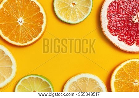 Flat Lay Composition With Slices Of Fresh Lemon Orange Grapefruit Lime On Yellow Background Top View