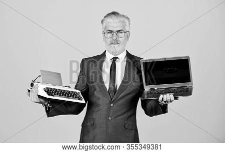 Mature Man Dyed Beard Hair. Computer Or Typewriter. New And Old Technology. Modern Digital Business.