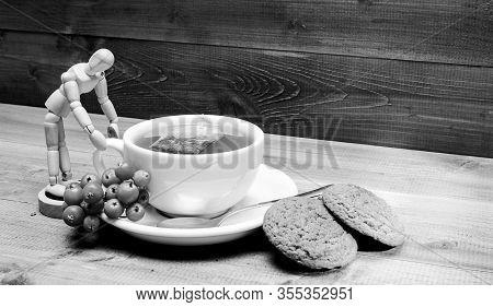 Ceramic Cup Hot Fresh Brewed Tea Beverage. Drink Aromatic Rowanberry Beverage. Health Care Folk Reme