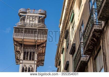 Elevador De Santa Justa In Lisbon, Portugal, Over Blue Sky